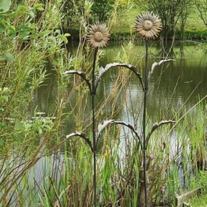 metal flower Sunflowers by lake